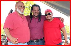 Castro embraces Faber and Saldivar at Clear the Land Bash